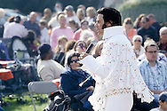 Warwick, New York - An  Elvis Presley impersonator sings for a crowd in a park during the Applefest  harvest celebration on Oct. 3, 2010.
