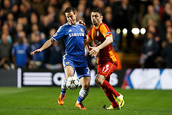 Chelsea Defender Cesar Azpilicueta (ESP) is challenged by Galatasaray Forward Burak Yilmaz (TUR) - Photo mandatory by-line: Rogan Thomson/JMP - 18/03/2014 - SPORT - FOOTBALL - Stamford Bridge, London - Chelsea v Galatasaray - UEFA Champions League Round of 16 Second leg.