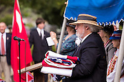 A descendants of Civil War soldiers retires the flag at a ceremony marking Confederate Memorial Day at Magnolia Cemetery April 10, 2014 in Charleston, SC. Confederate Memorial Day honors the approximately 258,000 Confederate soldiers that died in the American Civil War.