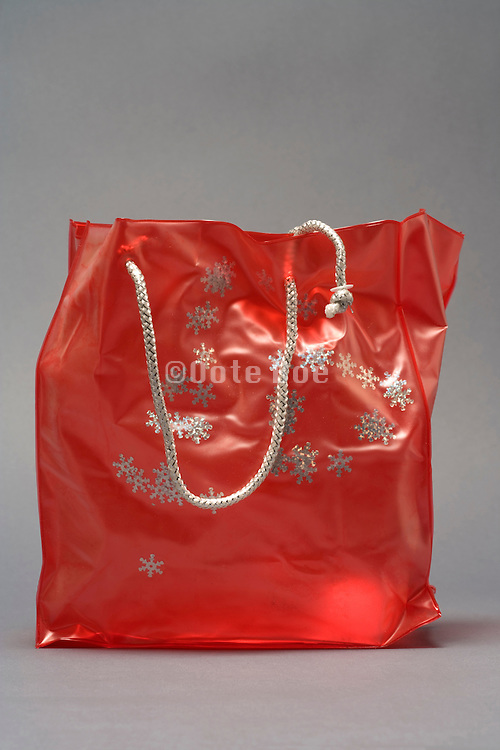 plastic shopping bag with snow stars decoration