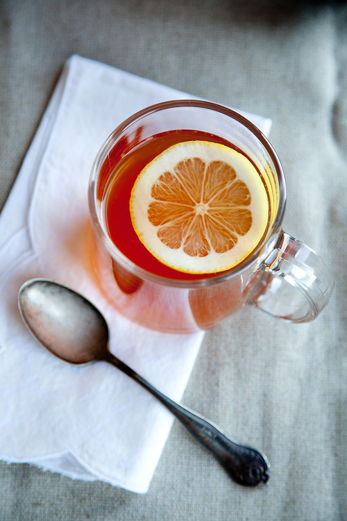 A hot toddy made with bourbon, honey and lemon juice.  A hot toddy is often used as a remedy for the common cold and sore throats.