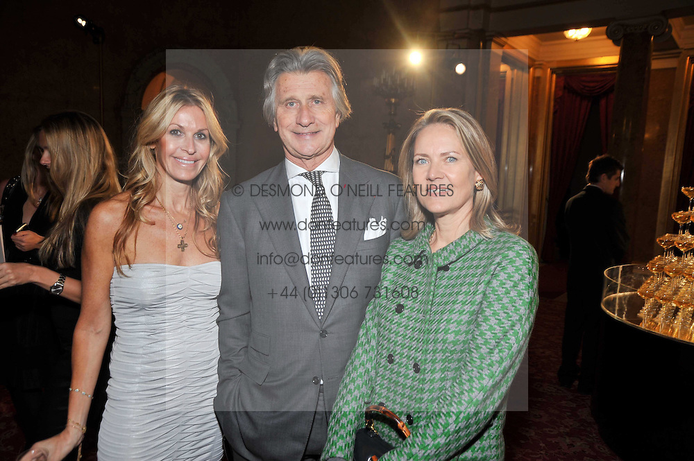 Left to right, MELISSA ODABASH and ARNAUD & CARLA BAMBERGER at a party to celebrate 300 years of Tatler magazine held at Lancaster House, London on 14th October 2009.