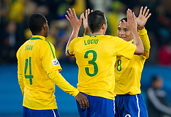 Juan, Lucio and Gilberto Silva of Brazil celebrate after third goal during the 2010 FIFA World Cup South Africa Round of Sixteen match between Brazil and Chile at Ellis Park Stadium on June 28, 2010 in Johannesburg, South Africa.  (Photo by Vid Ponikvar / Sportida)