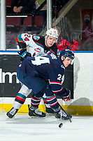 KELOWNA, BC - MARCH 7: Kyle Topping #24 of the Kelowna Rockets passes the puck as Dylan Cozens #24 of the Lethbridge Hurricanes checks during second period  at Prospera Place on March 7, 2020 in Kelowna, Canada. (Photo by Marissa Baecker/Shoot the Breeze)