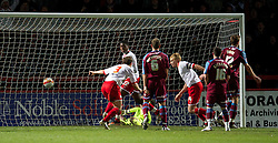 STEVENAGE, ENGLAND - Saturday, December 17, 2011: Stevenage's captain Mark Roberts scores the second goal against Tranmere Rovers during the Football League One match at Broadhall Way. (Pic by David Rawcliffe/Propaganda)