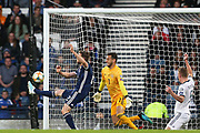 Scotland defender Stephen O'Donnell (2) (Kilmarnock) flicks on at the near post but Guilherme Marinato of Russia (1) (Locomotiv Moscow) blocks the chance during the UEFA European 2020 Qualifier match between Scotland and Russia at Hampden Park, Glasgow, United Kingdom on 6 September 2019.