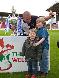 WREXHAM, WALES - Saturday, May 3, 2014: The New Saints' Philip Baker with children after winning the Welsh Cup during the Welsh Cup Final at the Racecourse Ground. (Pic by David Rawcliffe/Propaganda)