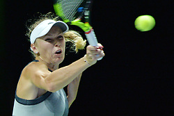 SINGAPORE, Oct. 23, 2017  Caroline Wozniacki of Denmark hits a return during the group match against Elina Svitolina of Ukraine at WTA Finals tennis tournament in Singapore, Oct. 23, 2017. (Credit Image: © Then Chih Wey/Xinhua via ZUMA Wire)
