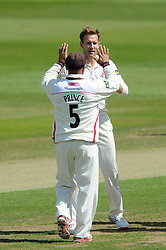 Kyle Jarvis of Lancashire celebrates with Ashwell Prince after bowling out Craig Miles of Gloucestershire for 12 in the second over  - Photo mandatory by-line: Dougie Allward/JMP - Mobile: 07966 386802 - 08/06/2015 - SPORT - Football - Bristol - County Ground - Gloucestershire Cricket v Lancashire Cricket Day 2 - LV= County Championship