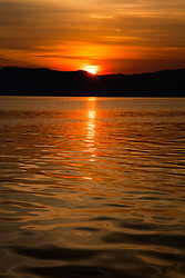 """Sunrise at Lake Tahoe 14"" - A sunrise photographed from a small fishing boat at Lake Tahoe, California."