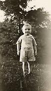 A happy little boy standing