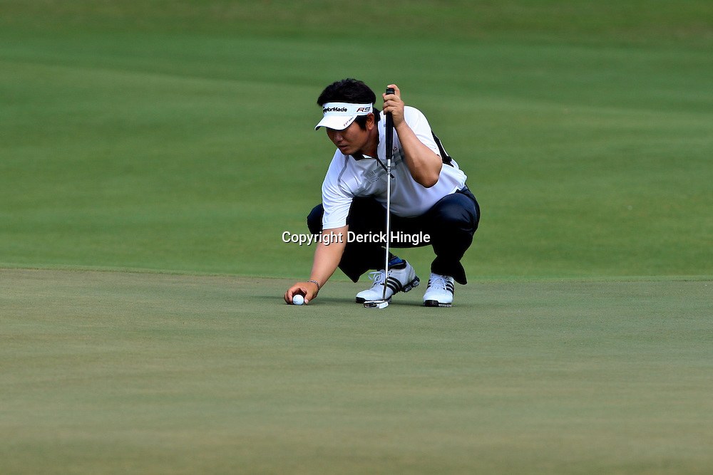 2009 April 24: PGA Tour golf pro Y.E. Yang putts on the 17th hole during the second round of the Zurich Classic of New Orleans PGA Tour golf tournament played at TPC Louisiana in Avondale, Louisiana.Yang on August 16, 2009 became the first Asian born PGA Player to win a major with his win in the PGA Championship in Chaska, Minnesota.