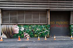 Street art mural on building in central Glasgow, Scotland, UK