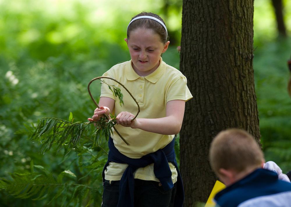 Children making dream catchers in the Forest School in Garscaden Woods, Glasgow, Scotland