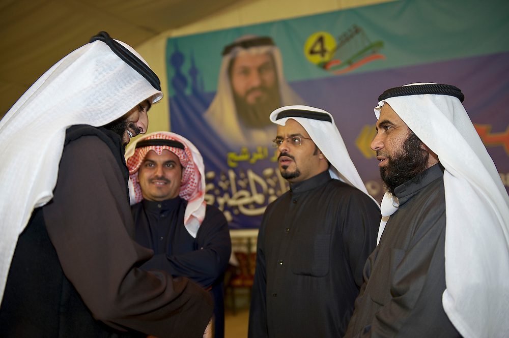 Supporters of former Kuwaiti MP Mohammed Hayef in discussions in a tent on the outskirts of Kuwait City, following his election in the parliamentary elections, February 3, 2012.  Kuwaiti chose among 285 candidates for the new 50-seat assembly.