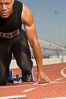 Male track athlete on starting block