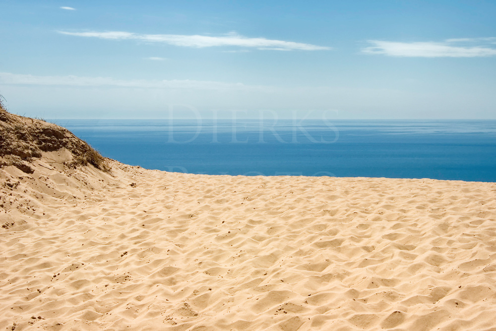 View of Lake Michigan blue water and sky from a 450 foot high sand dune at Sleeping Bear National Lakeshore, MI, USA.