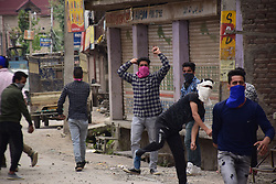 May 5, 2018 - Srinagar, Jammu & Kashmir, India - People clashes with forces near the Encounter site in Srinagar..4 Killed and several injured in an encounter between Indian forces and militants at chatabal area of Srinagar summer capital of Indian Kashmir on Saturday. Three militants were killed during a brief shootout after government forces laid seige around densely populated chatabal area of Srinagar. A young man also died after he was hit by the armoured vehicle during the clashes between the residents and police force as residents tried to help the Militants in escape. (Credit Image: © Abbas Idrees/SOPA Images via ZUMA Wire)