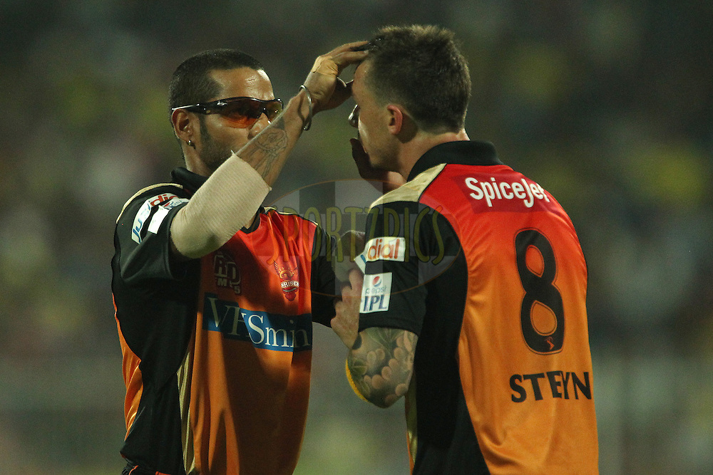 Shikhar Dhawan captain of the Sunrisers Hyderabad assists Dale Steyn of the Sunrisers Hyderabad with removing something from his eye during match 17 of the Pepsi Indian Premier League 2014 between the Sunrisers Hyderabad and the Chennai Superkings held at the Sharjah Cricket Stadium, Sharjah, United Arab Emirates on the 27th April 2014<br /> <br /> Photo by Ron Gaunt / IPL / SPORTZPICS