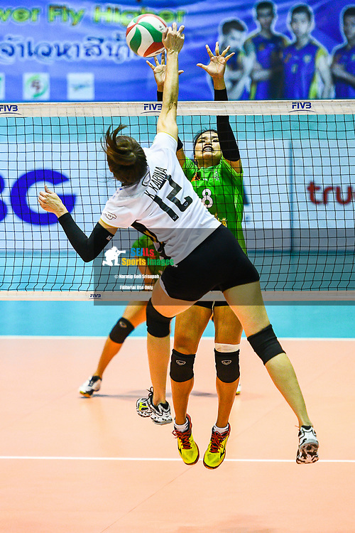 BANGKOK, THAILAND - MARCH 19: Karina Krause of Bangkok Glass #12 going for the spike against Duenpen Areelue of King-Bangkok VC #8 during the 2016–17 Women's Volleyball Thailand League, Chantarubeksa Air Force Stadium, Bangkok, Thailand on March 19, 2017.<br /> .<br /> .<br /> .<br /> (Photo by: Naratip Golf Srisupab/SEALs Sports Images)<br /> .<br /> Any image use must include a mandatory credit line adjacent to the content which should read: Naratip Golf Srisupab/SEALs Sports Images