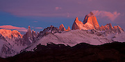 The brilliant light of a Patagonian sunrise illuminates Mt. Fitzroy in the Southern Andes, Argentina, South America