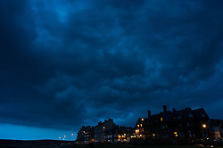 © Licensed to London News Pictures. 23/08/2013<br /> <br /> Saltburn, Cleveland, England, UK<br /> <br /> Thunder storms pass over homes in Saltburn in the northeast of England.<br /> <br /> Photo credit : Ian Forsyth/LNP