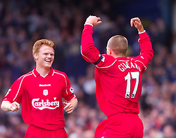 LIVERPOOL, ENGLAND - Saturday, September 15, 2001: Liverpool's captain Steven Gerrard celebrates scoring against  Everton with team-mate John Arne Riise during the Premiership match at Goodison Park. (Pic by David Rawcliffe/Propaganda)
