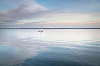 Sailboat anchored in Bellingham Bay on a calm morning, Bellingham,  Washington