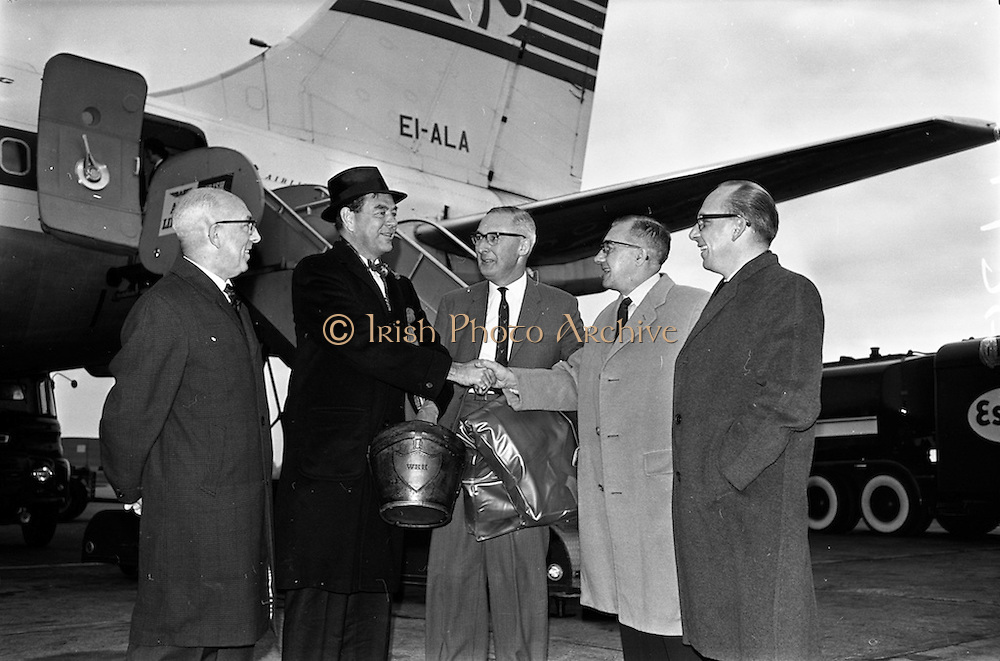 24/10/1962<br /> 10/24/1962<br /> 24 October 1962<br /> Mr John Bowles, President of Rexall Drugs, Los Angeles, arriving at Dublin Airport. Mr Bowles is greeted by Mr Eric Ridgeway, Director, Charnwood Laboratories, Loughborough, Leicestershire, England. Mr M. Richardson Managing Director Charnwood Laboratories, Loughborough, Leicestershire, England in centre; on left is Mr Gerald (?) Vaughan, Rexall Overseas Incorporated, Brussels.