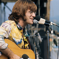 "John Sebastian.- .A man of many faces, clean shaven in The Lovin Spoonful, but now more relaxed as he was reunited with old colleague Zal Yanovski. Brian Hinton in his book ""Message to Love"" remembers him as being ubiquitous and a symbol of permanence - almost as if his presence was dependent on the success of the festival, he seemed to be everywhere!"