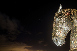 The International Space Station passes one of The Kelpies, the 30-metre high horse-head sculptures in The Helix, the parkland project in the Falkirk Council Area, Scotland, UK on the evening of the 14/2/2016.