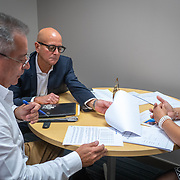 MARCH 14, 2018--CAROLINA, PUERTO RICO<br /> Felix B. Santos, President of Puerto Rico Hospital, middle, looks over some documents with  Jose M. Rivera, Director of sales to hospitals, and Jamalis Hernandez , sales department secretary. PRH is a principal supplier of medical supplies to hospitals in Puerto Rico. <br /> (PHOTO BY ANGELVALENTIN/FREELANCE)