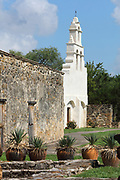 Campanario of the Mission San Juan, or Mission San Juan Capistrano, a Spanish catholic colonial mission and church established in 1731 with the church, priest's quarters and granary completed in 1756, to spread Christianity among Native Americans, 1 of 4 missions in the San Antonio Missions National Historical Park, in San Antonio, Texas, USA. The church was restored in 2012 and a lime plaster was added to its exterior. The mission is listed on the National Register of Historic Places and forms part of the San Antonio Missions UNESCO World Heritage Site. Picture by Manuel Cohen