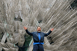 © Licensed to London News Pictures. 16/09/2015. London, UK. Chinese artist Ai Weiwei visits his new sculpture 'Forever' outside the Gherkin building in central London on Wednesday, 16 September 2015. Nearly 10 metres tall and 16 metres wide and consisting of 1,254 bicycle frames, the sculpture will be on display through May 2016. Photo credit: Tolga Akmen/LNP