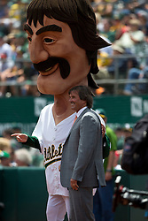OAKLAND, CA - JUNE 21:  Former Oakland Athletics player Dennis Eckersley stands next to a mascot on the field before the game against the Boston Red Sox at O.co Coliseum on June 21, 2014 in Oakland, California. The Oakland Athletics defeated the Boston Red Sox 2-1 in 10 innings.  (Photo by Jason O. Watson/Getty Images) *** Local Caption *** Dennis Eckersley