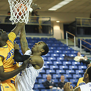 Delaware Guard Jarvis Threatt (4) drives to the basket as  Hofstra Forward Moussa Kone (31) defends in the first half of a NCAA regular season Colonial Athletic Association conference game between Delaware and Hofstra Wednesday, JAN 8, 2014 at The Bob Carpenter Sports Convocation Center in Newark Delaware.