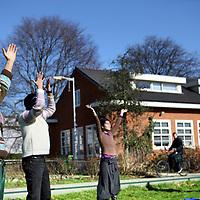 Nederland, Amsterdam , 11 maart 2012..Falun Dafa, een chinese spirituele beweging (soort van yoga). Zondag vindt er een training plaats in het Westerpark. De Falun Dafa wordt in China vervolgd. Mevrouw Wang geeft deze training en ook zij en haar familie worden in China vervolgd. Gaat om haar persoonlijke verhaal..Op de foto is Mevr. Wang niet aanwezig..People practicing Falun Dafa in Westerpark in Amsterdam. The Falun Gong is banned in China and practitioners are persecuted