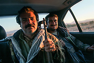 Hitch hikers. Kurdish Peshmerga, which means &quot;those who face death,&quot; fighters patrol along the military road where Ansar al-Islam Islamist extremists are active.<br /> Halabja, Iraqi Kurdistan. 20/11/2002.