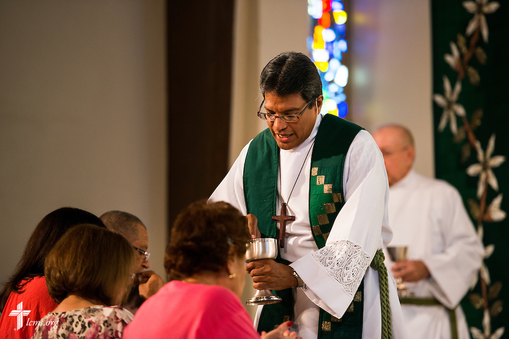 The Rev. Adolfo Borges, associate pastor at Prince of Peace Lutheran Church in Orlando, Fla., distributes the Sacrament at the church on Sunday, Sept. 13, 2015. LCMS Communications/Erik M. Lunsford