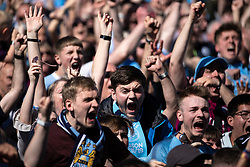 © Licensed to London News Pictures . 12/05/2019. Manchestr , UK . Manchester City equalise - 1-1 . Manchester City supporters watch the club's Premier League match at Brighton on a big screen in City Square at the Etihad Stadium. If Manchester City win the match they will win the title for the second time in a row . Photo credit : Joel Goodman/LNP/LNP