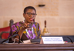 © Licensed to London News Pictures. 22/10/2018. Bristol, UK. Global Parliament of Mayors Annual Summit, 21-23 October 2018, at Bristol City Hall. Picture of YVONNE AKI-SAWYERR, mayor of Freetown, Sierra Leone, taking part in the plenary session on harnessing the power of migration. The Global Parliament of Mayors 2018 is the biggest and most ambitious Annual Summit to date. GPM Bristol 2018 will host up to 100 global mayors for an action-focused summit that addresses some of the biggest challenges facing today's world cities. GPM Bristol 2018's theme, Empowering Cities as Drivers of Change, will focus minds on global governance and the urgent need for the influence, expertise and leadership of cities to be felt as international policy is shaped. GPM Bristol 2018 will provide mayoral delegates with a global network of connections and a space to develop the collective city voice necessary to drive positive change. The programme will engage participants in decision-making, with panels, debate and voting on priority issues including migration and inclusion, urban security and health, and is a unique chance to influence decisions on the most pressing issues of our time. Photo credit: Simon Chapman/LNP