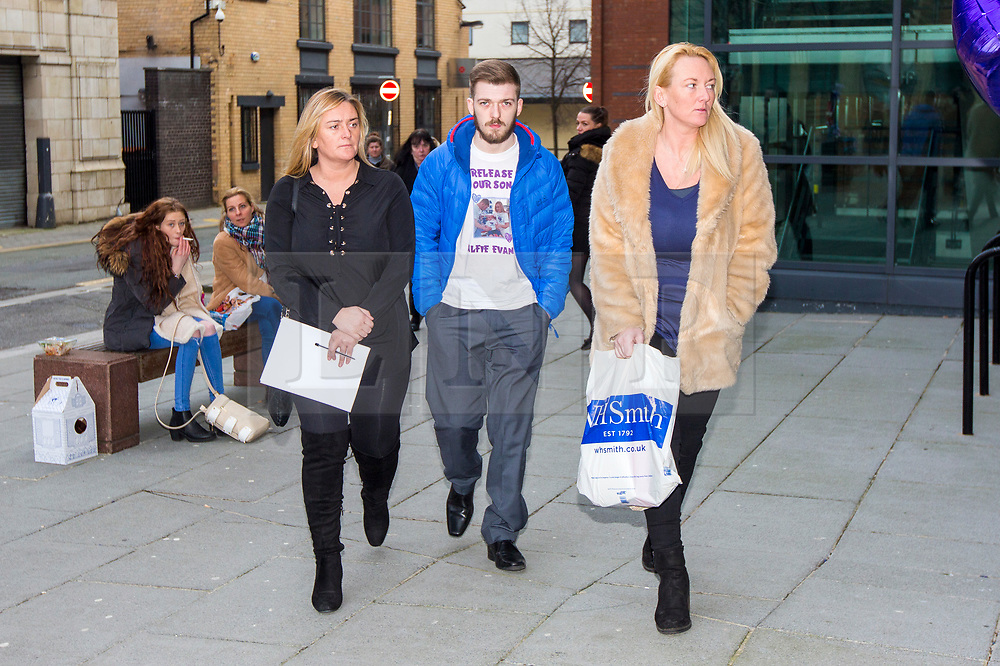 """© Licensed to London News Pictures. 07/02/2018. Liverpool, UK. Tom Evans, father of Alfie Evans with supporters at Liverpool Civil & Family Court today. Tom Evans and Kate James from Liverpool are in dispute with medics looking after their son 19-month-old son Alfie Evans, at Alder Hey Children's Hospital in Liverpool. Alfie is in a """"semi-vegetative state"""" and had a degenerative neurological condition doctors have not definitively diagnosed. Specialists at Alder Hey say continuing life-support treatment is not in Alfie's best interests but the boy's parents want permission to fly their son to a hospital in Rome for possible diagnosis and treatment. Photo credit: Andrew McCaren/LNP"""