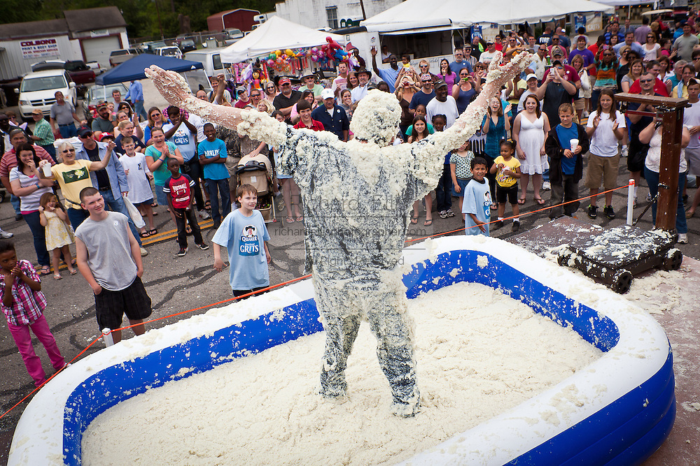 A participant in the Grits Roll after wallowing in a pool of grits during the annual World Grits Festival in St George, SC