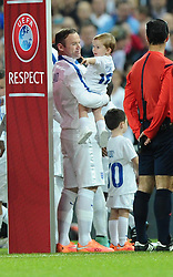 Wayne Rooney of England (Manchester United) makes his 100th appearance for England with his two sons   - Photo mandatory by-line: Joe Meredith/JMP - Mobile: 07966 386802 - 15/11/2014 - SPORT - Football - London - Wembley - England v Slovenia - EURO 2016 Qualifier