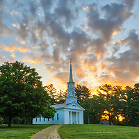 Massachusetts sunrise photography of the iconic white spire Martha-Mary Chapel in Sudbury, MA located within the Wayside Inn Historic District on a beautiful spring morning.<br />