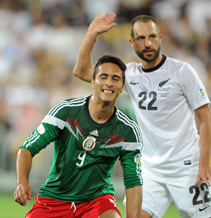 Mexico's Aldo de Nigris plays in front of New Zealand's Andrew Durante in the World Cup Football qualifier, Westpac Stadium, Wellington, New Zealand, Wednesday, November 20, 2013. Credit:SNPA / Ross Setford