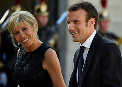 French Minister of Economy, Recovery of Productivity and Digital Affairs Emmanuel Macron and wife Brigitte Trogneux arriving at the Elysee Palace for a state dinner in honor of King Felipe VI and Queen Letizia of Spain, in Paris, France on June 2, 2015. The Spanish royal couple, who cut short their March 2015 state visit to France after a Germanwings Airbus crashed in the French Alps killing 45 Spanish citizens, are on a three-day official state visit to France. Photo by Christian Liewig/ABACAPRESS.COM    503088_087 Paris TraductionPae France