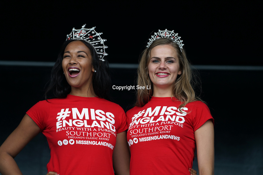 London, UK, 3rd August 2014 : Miss England 2016 Elizabeth Grant  and  Miss Sussex Victoria Smart to gives a lucky draw hoilday to Mauritian for attendees at the Mauritian Open Air Festival 2016 at Gunnersbury Park in London,UK. © See Li/PictureCapital
