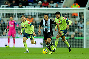 Isaac Hayden (#14) of Newcastle United brings the ball up the pitch during the Premier League match between Newcastle United and Bournemouth at St. James's Park, Newcastle, England on 9 November 2019.