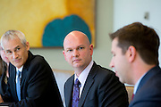 Evan Inglis and Dave Wilson listen to James Colon gives remarks during an interview at Nuveen Asset Management in downtown Chicago, Ill., on Wednesday, September 23, 2015.